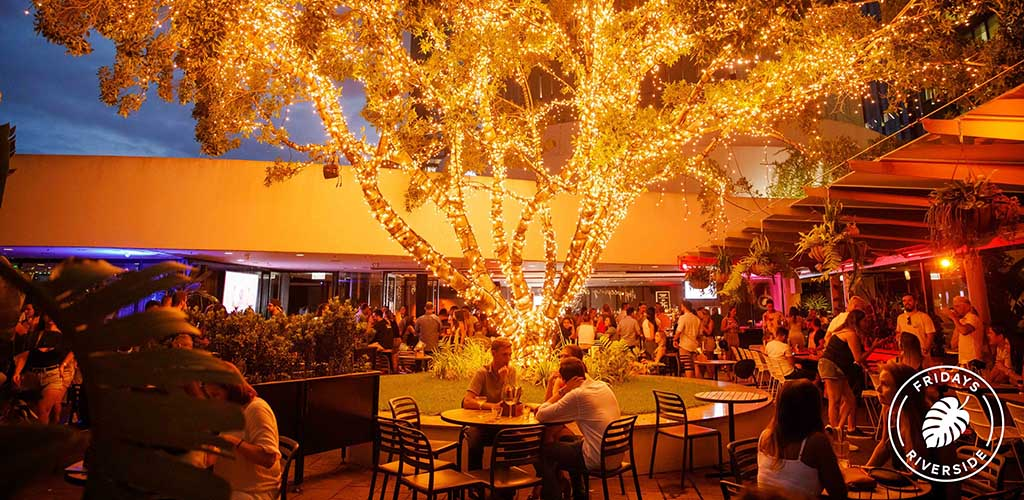 The brightly lit tree at the patio of Fridays Riverside