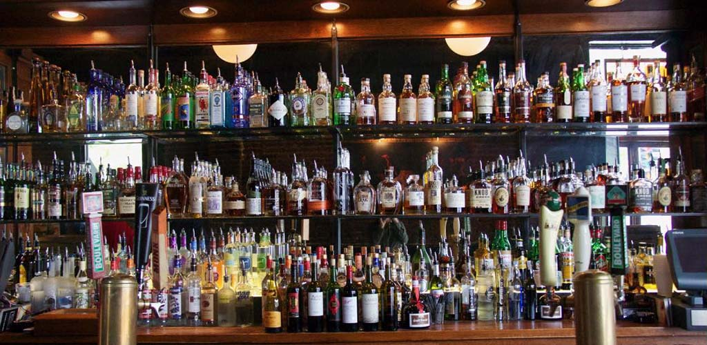 The fully stocked bar of Harry's Bar and Tables