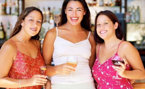 Boston MILFs holding their drinks at a bar