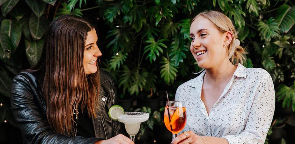 Friends enjoying cocktails at Story Bridge Hotel