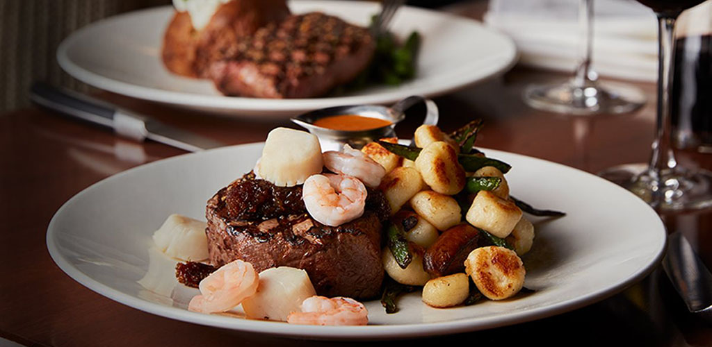 A steak and seafood dish from The Keg Steakhouse and Bar