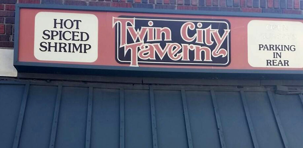 The sign at Twin City Tavern