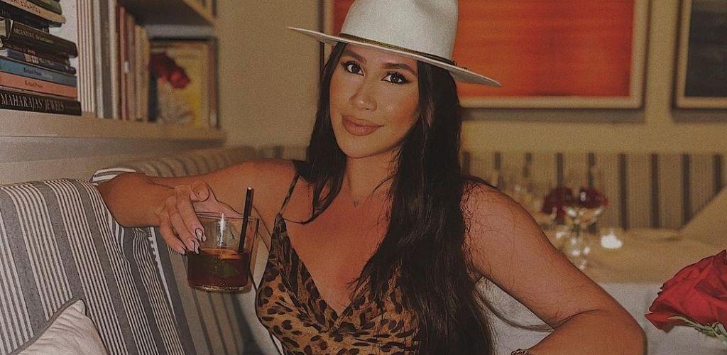A hot Miami cougar wearing a hat and drinking Martini at Casa Tua