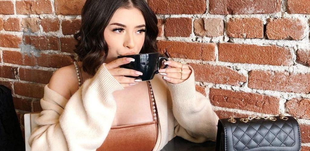Young Long Beach cougar drinking coffee at Recreational Coffee