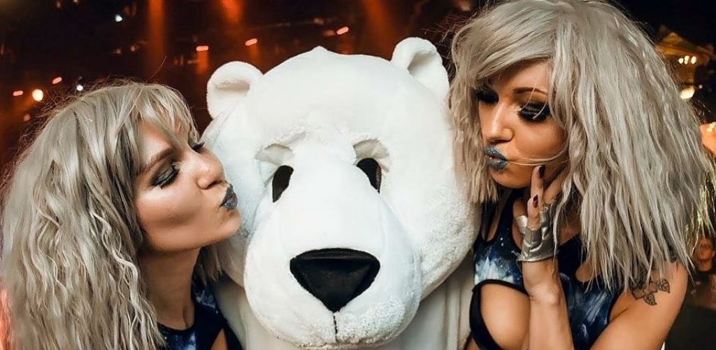 Go-go dancers with a mascot at Royale Boston Nightclub where Boston MILFs hangout