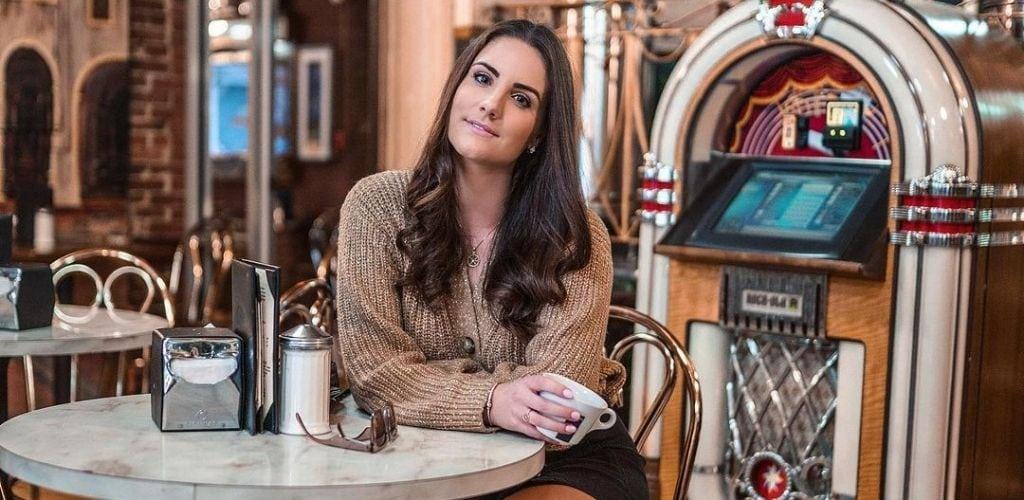 A Boston MILF enjoying a cup of coffee at Vittoria Caffe