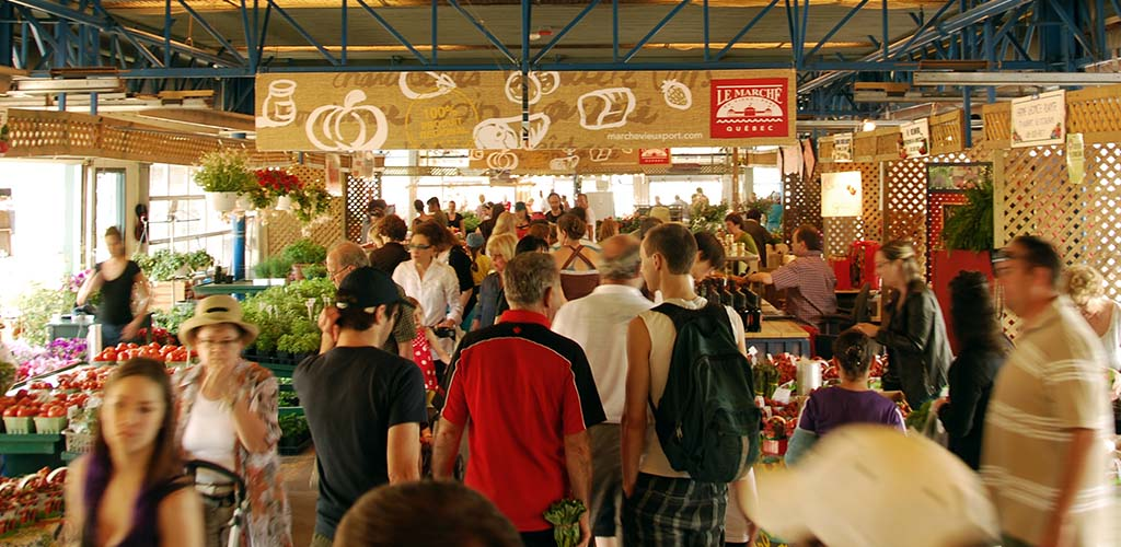 A crowd of people shopping at Marché du Vieux-Port