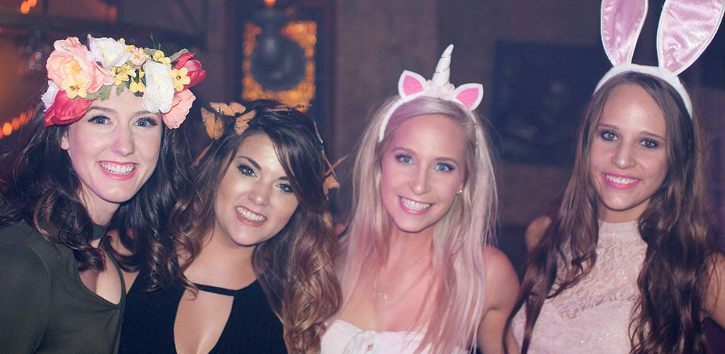 Friends in cute costumes for an event at Groovy's