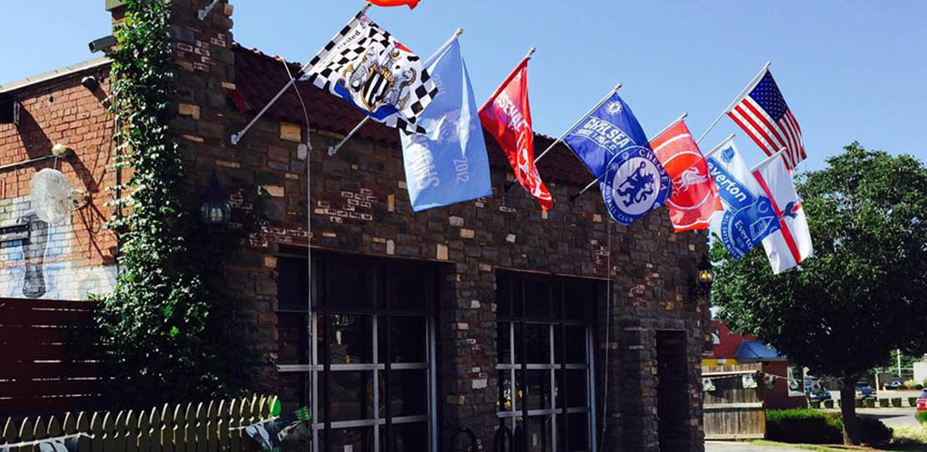 Various sports flags outside The Empire