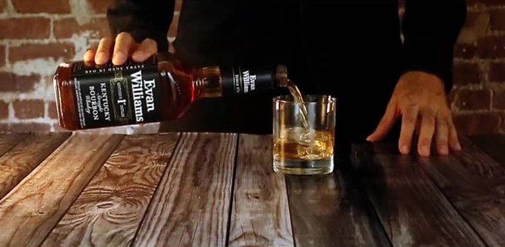Pouring a drink at Evan Williams Bourbon Experience