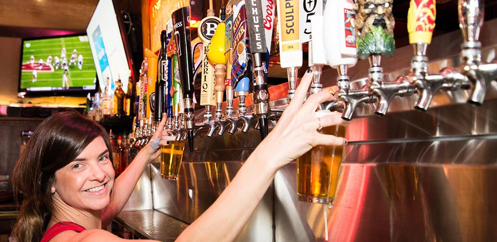 The various beer taps at Frog and Firkin