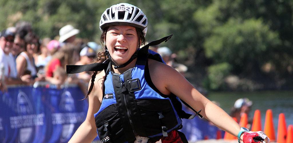 Woman running The Great Race Triathlon