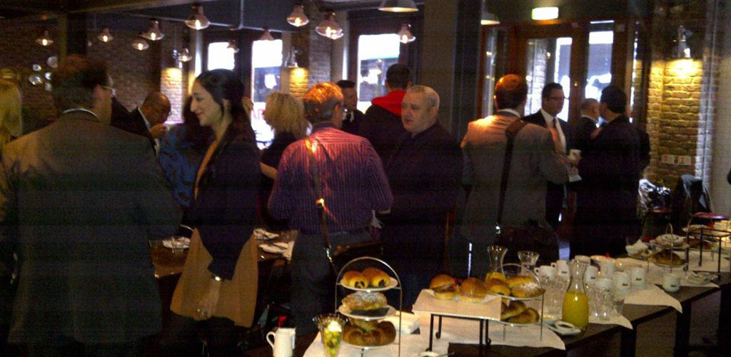 People gathered around the buffet table at Hanover Street Social