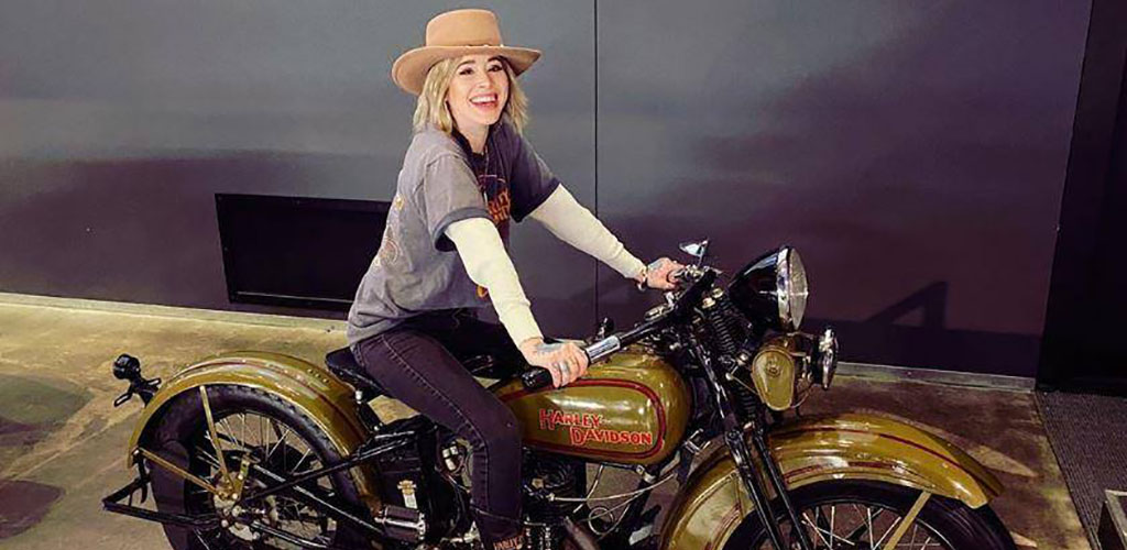 A woman on a motorbike at Harley Davidson Museum