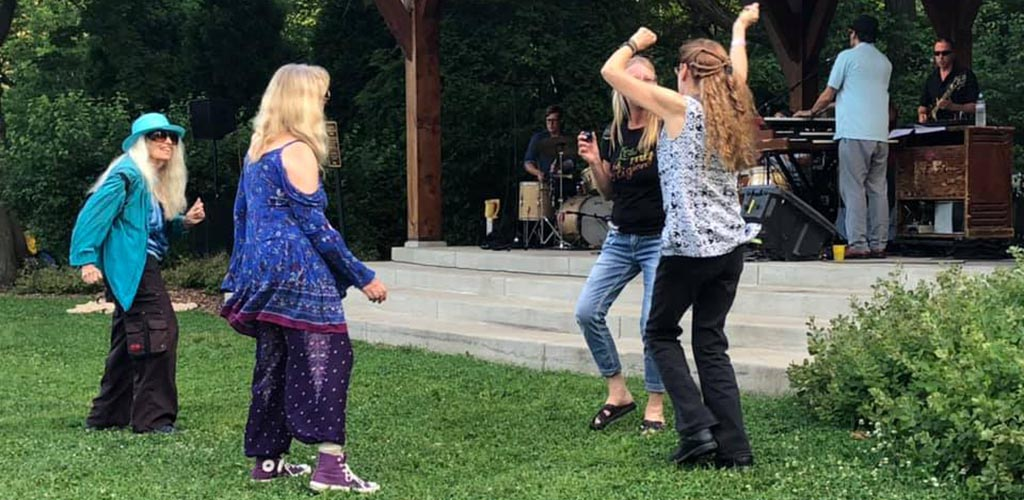 Women dancing at Lake Park