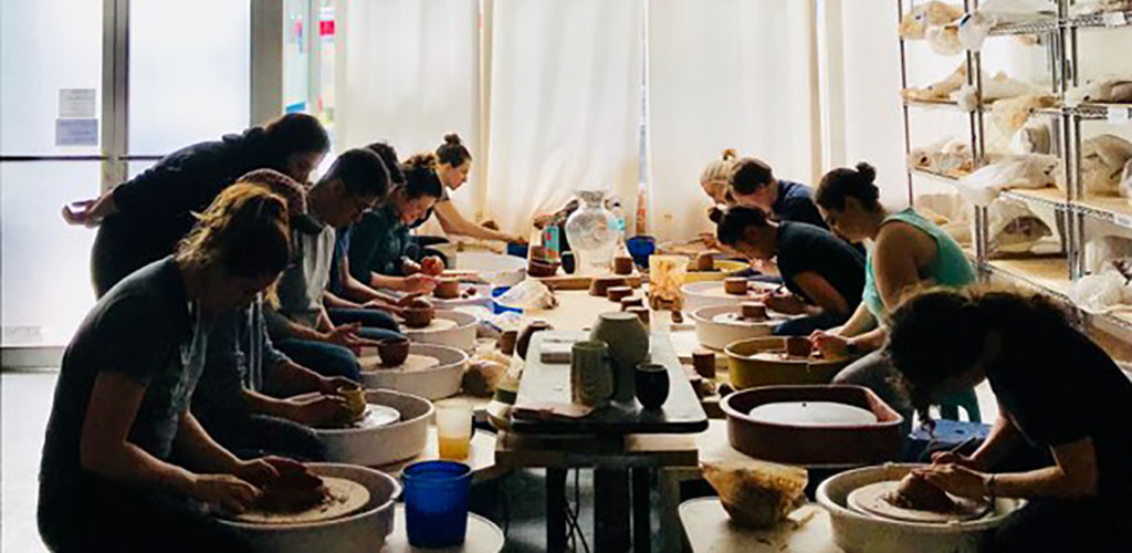 A class using pottery wheels at Mel Rice Ceramica
