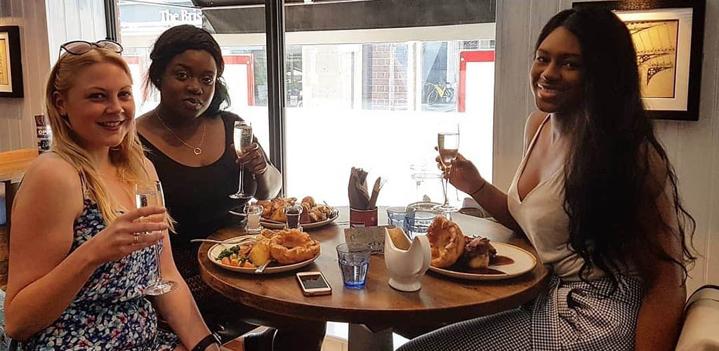 Friends having brunch at Prince Street Social
