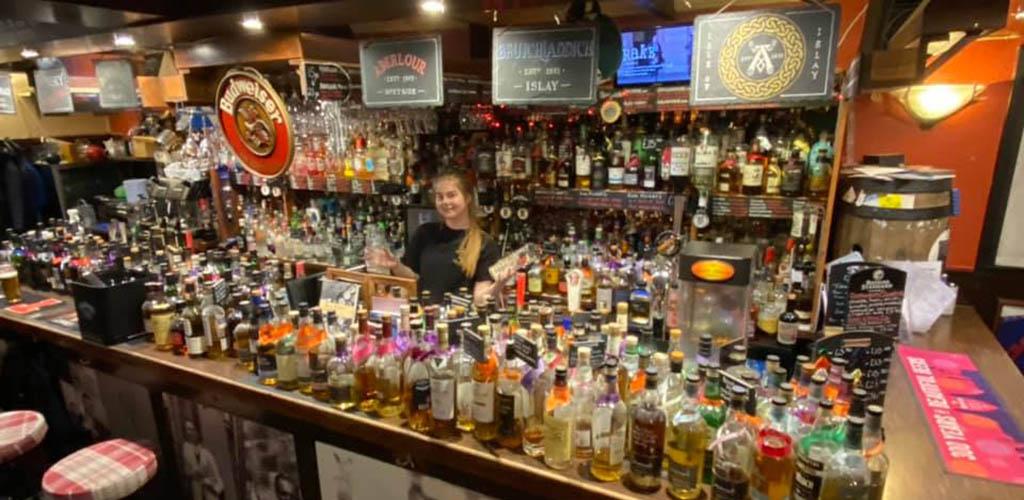 The fully stocked bar at The Keys
