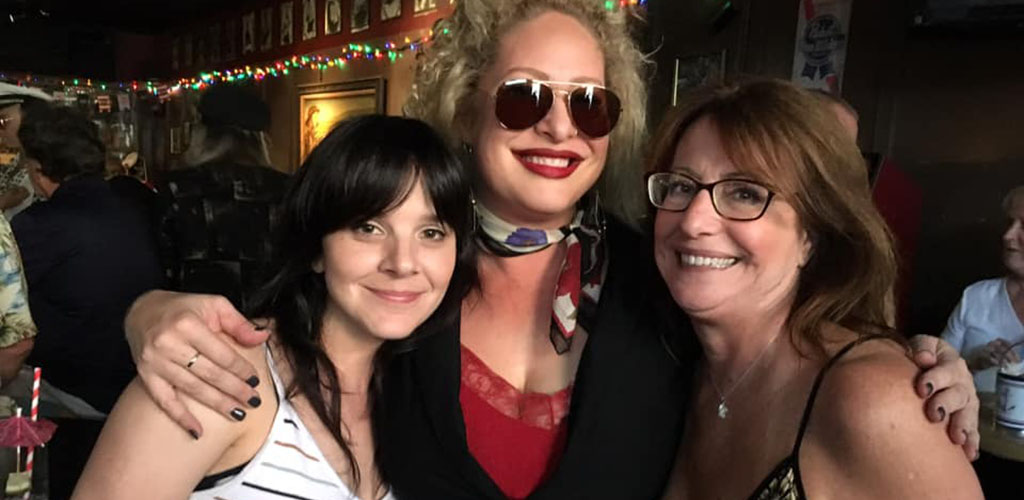 A trio of MILFs in Sacramento smiling at The Torch Club