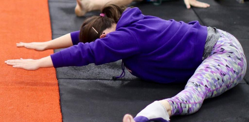Doing yoga at Unity Gym