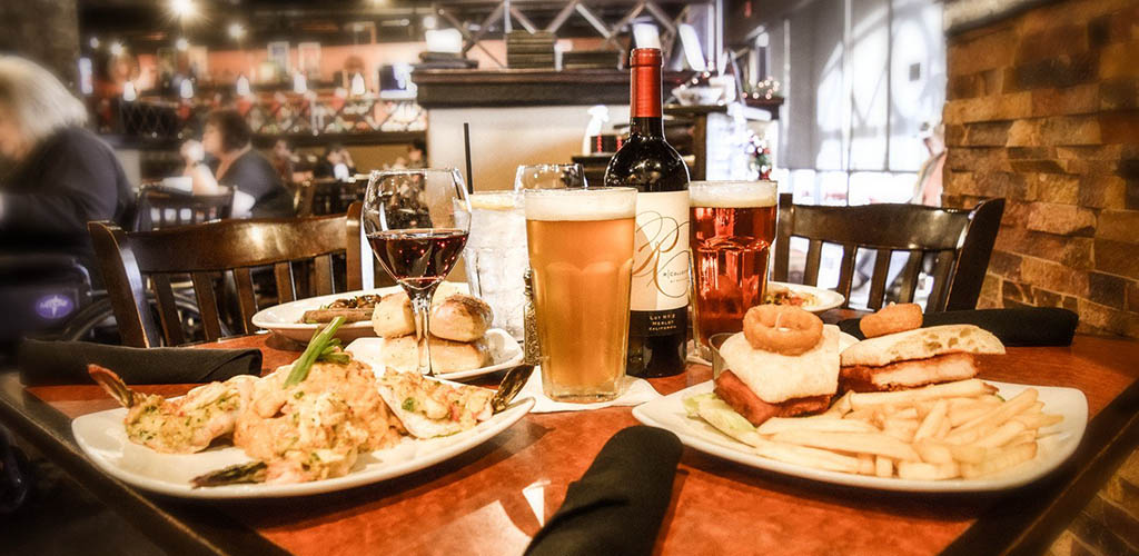 Various dishes and wine from Red White and Brew