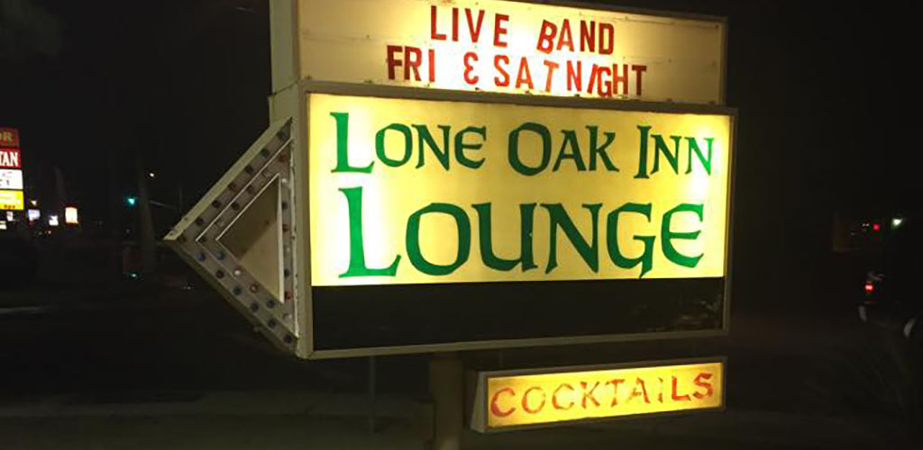The sign of Lone Oak Lounge Bar