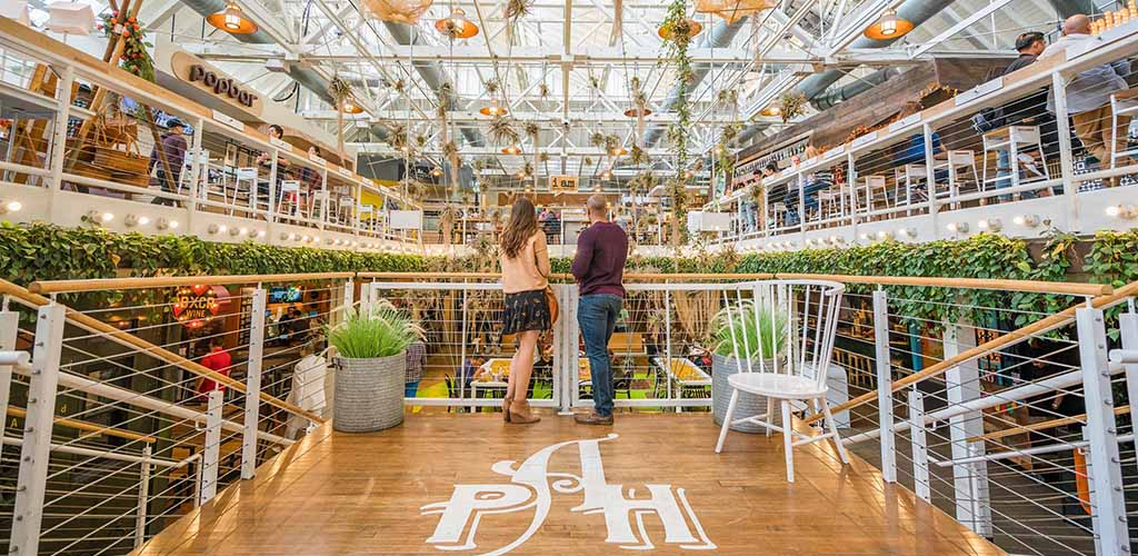A foodie couple on a date at Anaheim Packing District