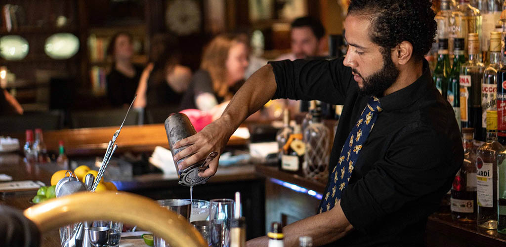 The bartender at The Bombay Club mixing drinks