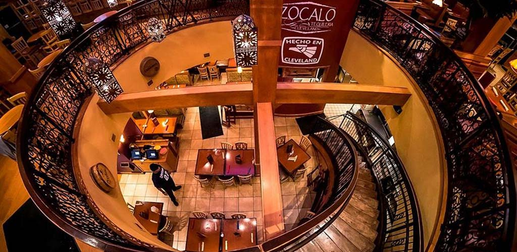 The grand spiral staircase at Zocalo Tequileria