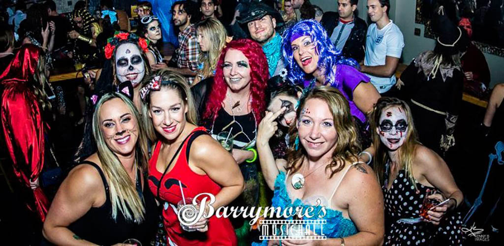 Partygoers in Halloween costumes are Barrymore's Music Hall