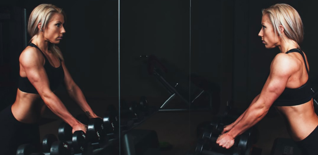 A fit woman working out at Fitspace