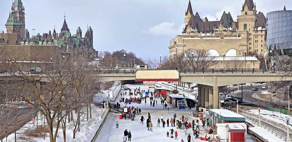 People skating on Rideau Canal in the winter