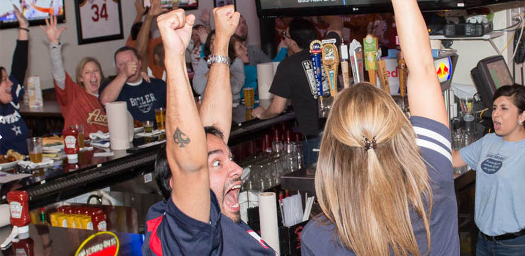 Sports fans at Pluckers Wings Bar celebrating a win