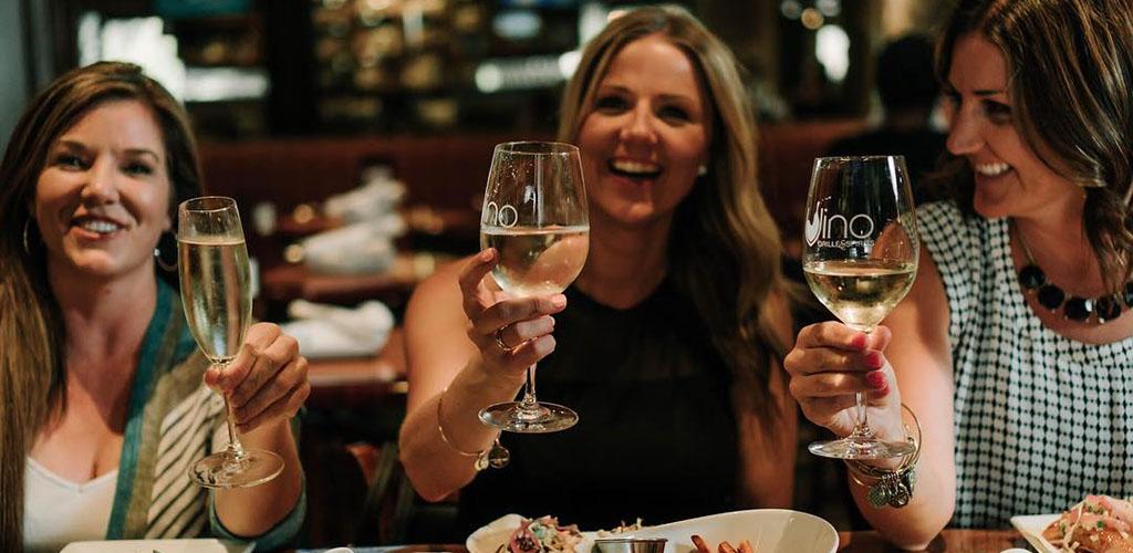 Cougars in Fresno enjoying white wine from Vino Grille & Spirits