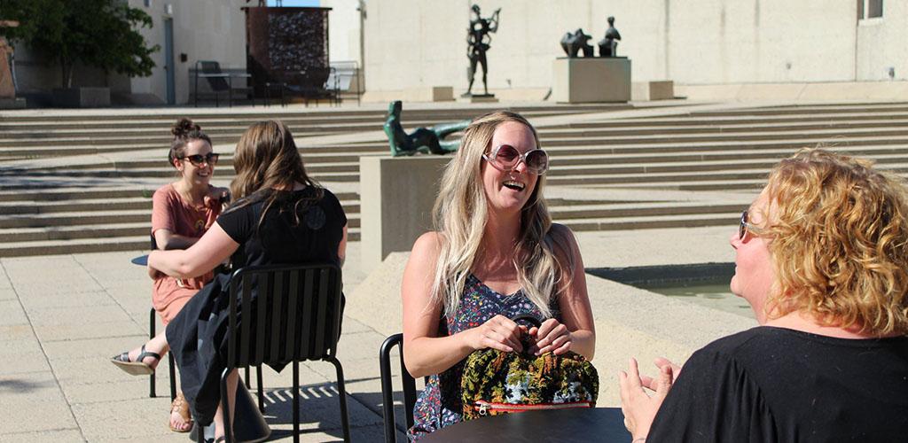 Cougars in Winnipeg sitting in the sun outside Winnipeg Art Gallery