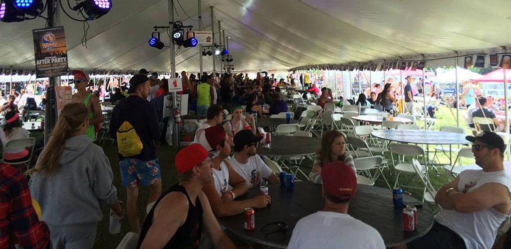 Friends drinking in a tent at Winnipeg Rec League