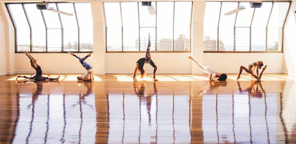 A class at the brightly lit Yoga Loft