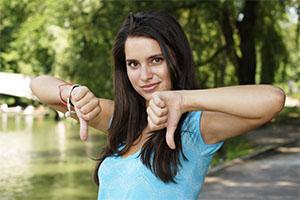 woman giving thumbs down