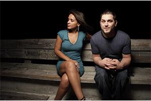 socially awkward man sitting besides woman
