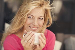 Older woman in Pretoria having a drink of coffee