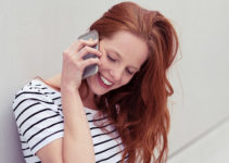 Redhead Tulsa MILF smiling on the phone