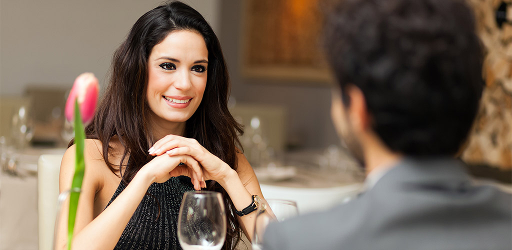 On a romantic dinner date at an upscale restaurant