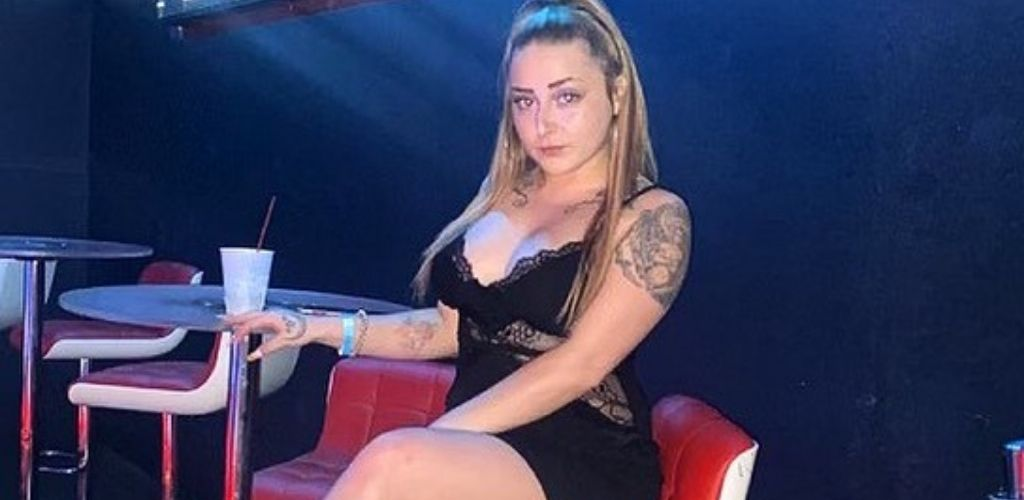 A young St. Louis MILF enjoying a drink at Europe Nightclub