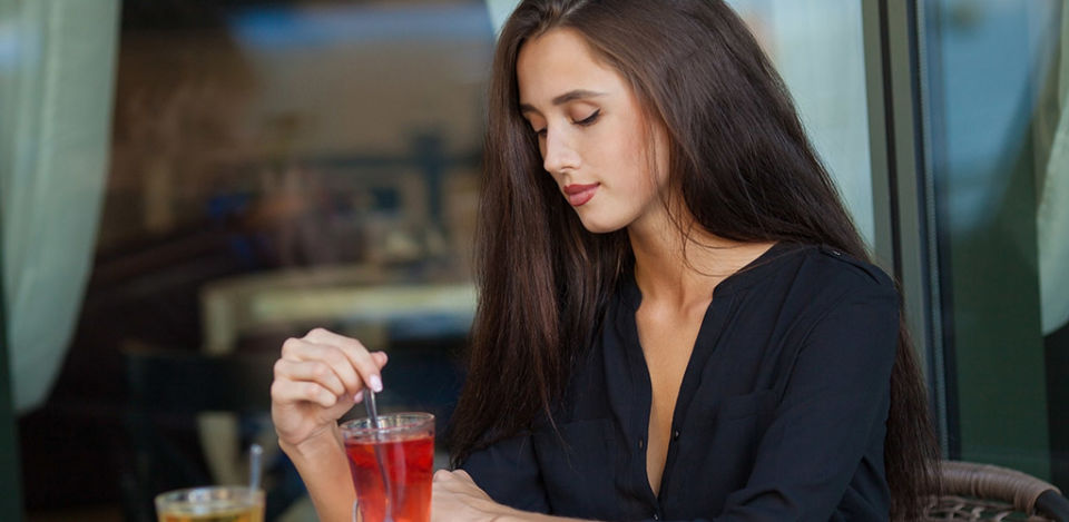 A hot cougar in North Carolina drinking tea in a cafe