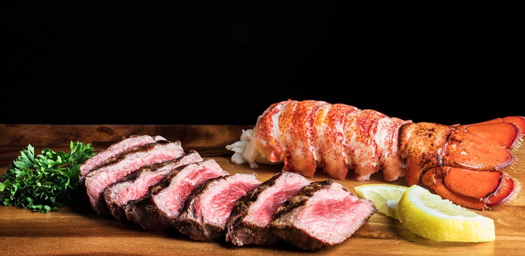 A medium rare steak and lobster tail from 111 Chophouse