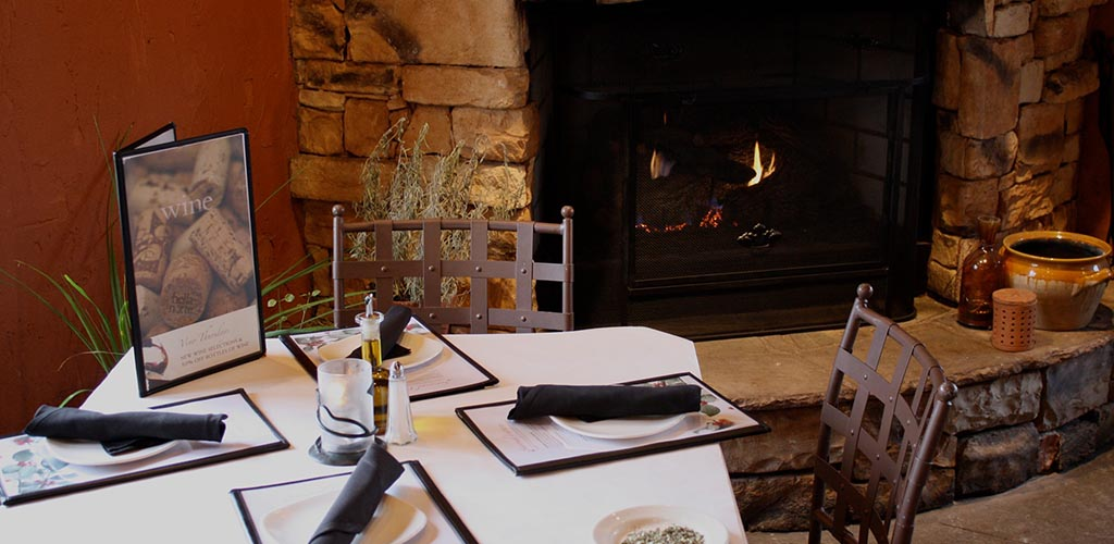 A cozy seat by the fireplace at Bella Notte