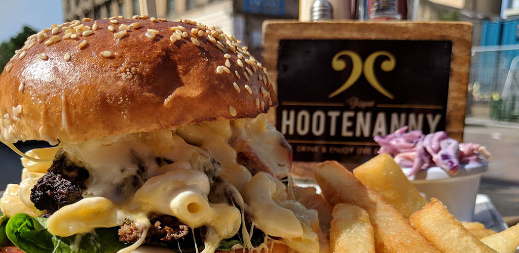 A burger stuffed with mac n cheese from Hootenanny