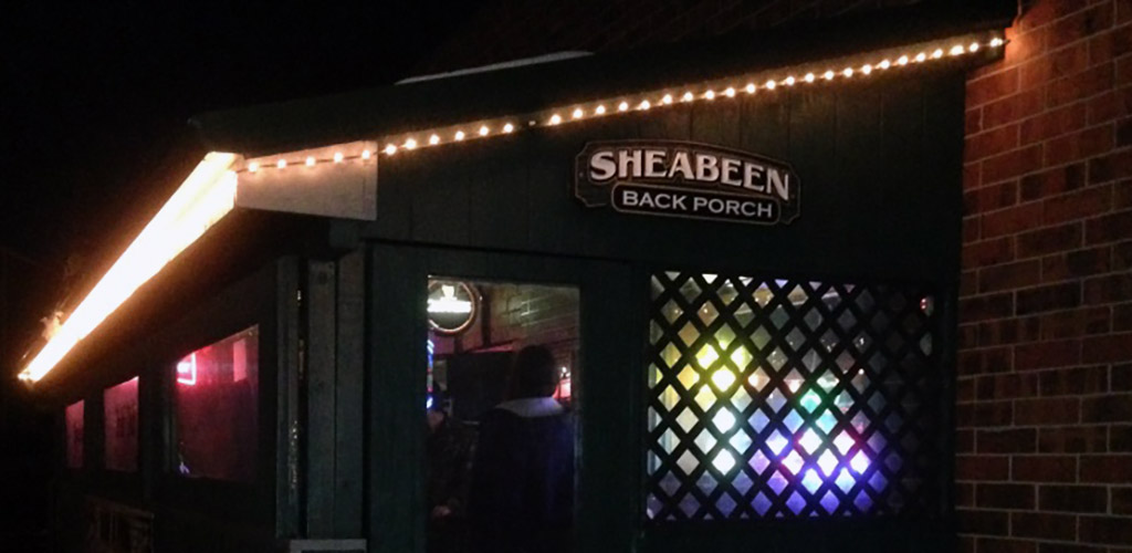 The rustic back porch of Sheabeen Irish Pub