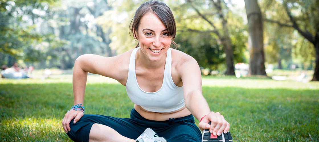 A fit woman exercising at the park