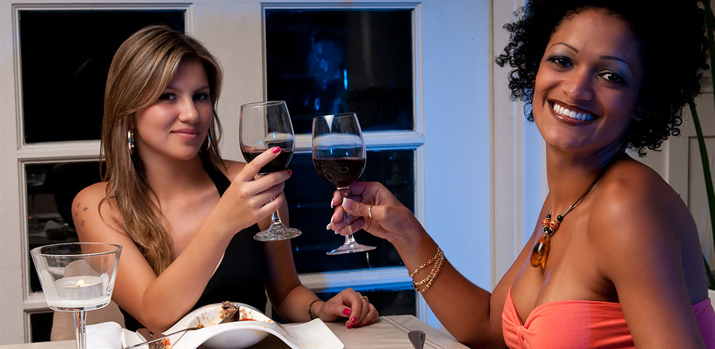 Friends having wine with dinner